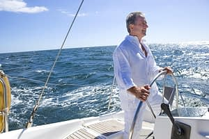 Retired Man Driving Yacht